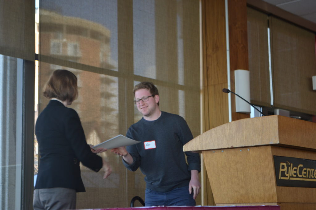 Benjamin Black, pictured receiving award from Department Chair Caroline Levine