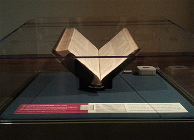 """The First Folio sat under a glass case on its altar in the center of a room, displaying Hamlet's famous soliloquy: """"To be, or not to be."""""""