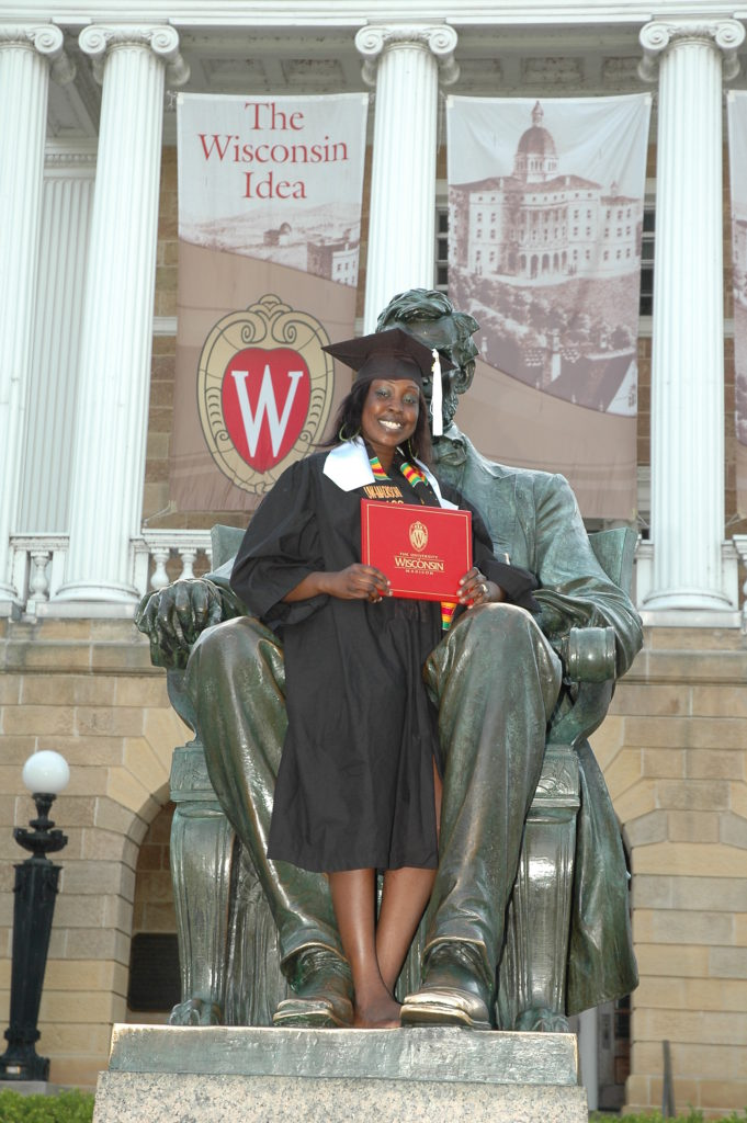 Odyssey Article Picture - Graduate with Abraham Lincoln statue